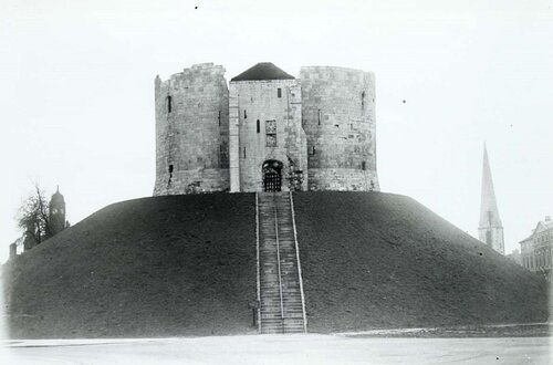 Black and white image of cliffords tower a stone tower on a hill
